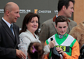 June 10th 2017, Chester Racecourse, Cheshire, England; Chester Races Horse racing; Jockey Adam McNamara picks up his winning prize for leading Starlight Romance to victory in the Liverpool Gin Stakes
