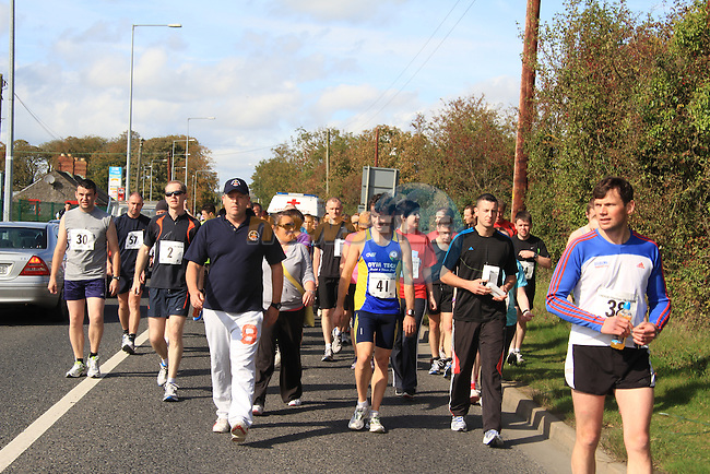 A rolling start to the 10k as the participants move from the retail park at walking pace..Picture: Shane Maguire / www.newsfile.ie