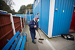 Ramsbottom United 1 Barwell 3, 03/10/2015. Riverside Stadium, Northern Premier League. Jack Wolfenden, aged 83, sweeping up rubbish outside dressing rooms at the Harry Williams Riverside Stadium, home to Ramsbottom United after they played Barwell in a Northern Premier League premier division match. This was the club's 13th league game of the season and they were still to record their first victory following a 3-1 defeat, watched by a crowd of 176. Rams bottom United were formed by Harry Williams, the current chairman, in 1966 and progressed from local amateur football  in Bury to the semi-professional leagues. Photo by Colin McPherson.