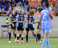 Alyssa Mautz (4) of the Chicago Red Stars congratulates Christen Press on her goal in the first half putting Chicago up 1-0 over the Houston Dash  on Saturday, April 16, 2016 at BBVA Compass Stadium in Houston Texas.