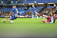 Andriy Yarmolenko of West Ham United fouls Emerson Palmieri Of Chelsea FC during Chelsea vs West Ham United, Premier League Football at Stamford Bridge on 30th November 2019