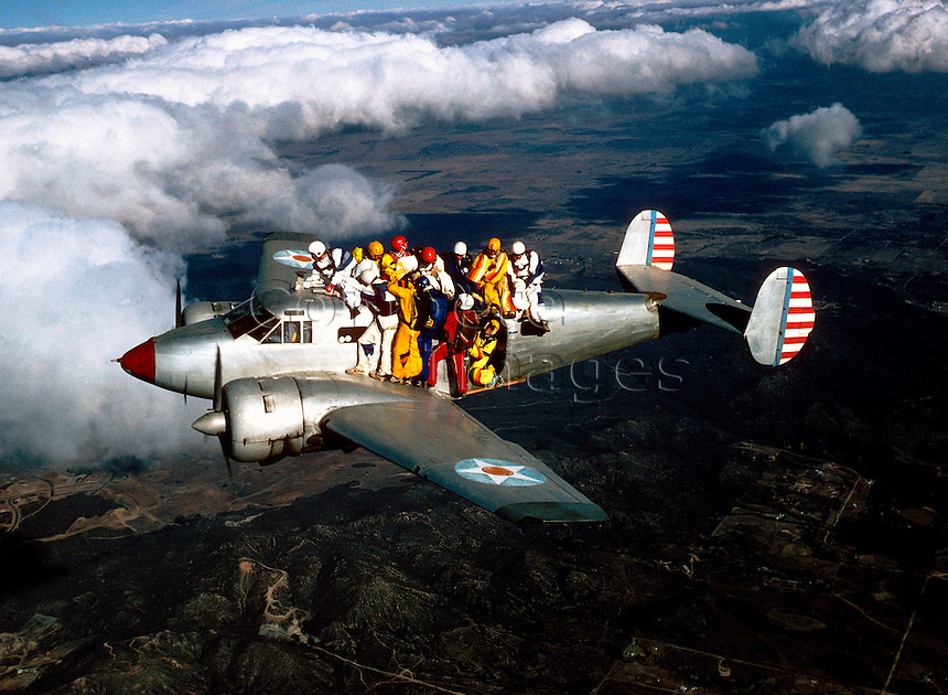 Group of sky divers on a plane.