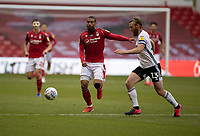 7th July 2020; City Ground, Nottinghamshire, Midlands, England; English Championship Football, Nottingham Forest versus Fulham; Alfa Semedo of Notts Forest challenges for the ball with Tim Ream of Fulham