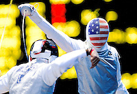 31 JUL 2012 - LONDON, GBR - Miles Chamley-Watson (USA) (right) of the USA attacks Alaaeidin Abouelkassem (EGY) of Egypt during their round of 32 men's individual foil match at the ExCel Exhibition Centre in London Docklands, London, Great Britain .(PHOTO (C) 2012 NIGEL FARROW)