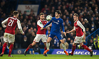Alvaro Morata of Chelsea surrounded by Shkodran Mustafi  & Rob Holding of Arsenal during the Carabao Cup semi final 1st leg match between Chelsea and Arsenal at Stamford Bridge, London, England on 10 January 2018. Photo by Andy Rowland.