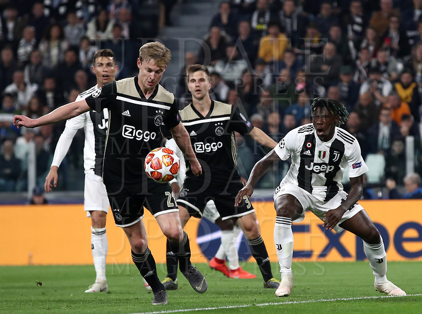 Football Soccer: UEFA Champions UEFA Champions League quarter final second leg Juventus - Ajax, Allianz Stadium, Turin, Italy, March 12, 2019. <br /> Ajax's Frenkie de Jong (l) in action with Juventu's Moise Kean (r) during the Uefa Champions League football match between Juventus and Ajax  at the Allianz Stadium, on March 12, 2019.<br /> UPDATE IMAGES PRESS/Isabella Bonotto