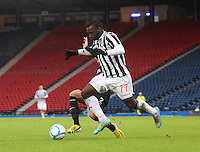 Adam Matthews gets a foot in on Esmael Goncalves in the St Mirren v Celtic Scottish Communities League Cup Semi Final match played at Hampden Park, Glasgow on 27.1.13.