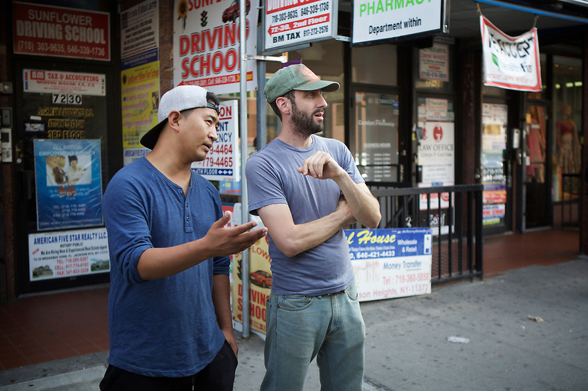 Queens, NY - July 10, 2017: Jeff Orlick chats with Pasang Thinlay, owner of the Momo Bros. food truck in  Jackson Heights.<br /><br />Credit: Clay Williams for Edible Queens.