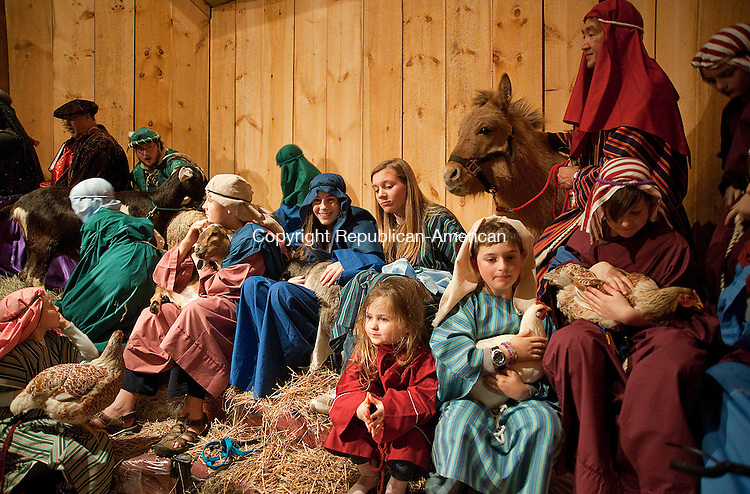 WINSTED, CT-010414JS09-The shepherds sit with the animals during the 24th Annual Boar's Head Festival Saturday at the First Church of Winsted. The even continues with a show today (Sunday) at 4 p.m. Tickets are still available at the door.  Jim Shannon Republican-American