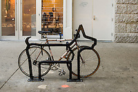 "One of nine bicycle racks, designed by David Byrne of the Talking Heads, entitled ""The Villager"" on LaGuardia Place."