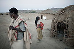 NAZARETH, ETHIOPIA - NOVEMBER 10: Residents daily life in a poor Pastoral village on November 10, 2010 outside Nazareth, Ethiopia. Most of the children here work with the animals only come to school because of a WFP feeding scheme. Many walk for an hour or two to school every morning. (Photo by: Per-Anders Pettersson)