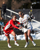 Boston College attacker Covie Stanwick (8) on the attack as Boston University midfielder Becca Church (19) defends..Boston College (white) defeated Boston University (red), 12-9, on the Newton Campus Lacrosse Field at Boston College, on March 20, 2013.