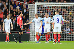 England's players argue with referee Antonio Miguel Mateu after the Netherland's second goal during the International friendly match at Wembley.  Photo credit should read: David Klein/Sportimage