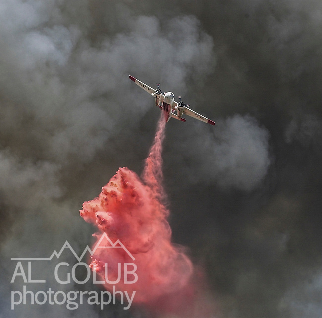August 18, 2001 Coulterville, California  -- Creek Fire – Air tanker drops retardant on active fire line near Alan Haigh Ranch.  The Creek Fire burned 11,500 acres between Highway 49 and Priest-Coulterville Road a few miles north of Coulterville, California.