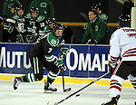 OMAHA, NE - FEBRUARY 9:  Danny Kristo #7 from the University of North Dakota brings the puck up as Michael Young #7 from the University of Nebraska Omaha defends in the first period at the Battle on Ice Saturday at TD Ameritrade in Omaha, NE. (Photo by Dave Eggen/Inertia)