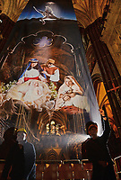 BNPS.co.uk (01202 558833)<br /> Pic: ZacharyCulpin/BNPS<br /> <br /> Pictured: Workers put the finishing touches to the nativity.<br /> <br /> One of the UK's most historic cathedrals today unveiled a 40ft Renaissance-style photographic tableau as its nativity - with its very own clergy, volunteers and staff starring as figures from the Christian scene.<br /> <br /> Salisbury Cathedral's spectacular nativity features its stonemason as Joseph, a bookings agent as Mary, a retired postman as a shepherd, a Canon and guides as Wise Men - and the son of an ex-England rugby player as baby Jesus.<br /> <br /> The Wiltshire cathedral wanted to put a modern twist on the traditional Christmas scene and cast people as Nativity characters before holding a series of individual and group photoshoots.