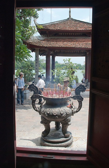 Hanoi, Vietnam, Worshiping at Ngoc Son, (Jade Mountain) Temple. photo taken July 2008.