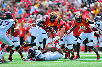 RB Brandon Ross of the Terrapins breaks a tackle. Maryland defeated Richmond 50-21 during home season opener at the Byrd Stadium in College Park, MD on Saturday, September 5, 2015.  Alan P. Santos/DC Sports Box