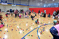 NWA Democrat-Gazette/J.T. WAMPLER Children collect treat-filled eggs Sunday April 14, 2019 during Easter at the Club at the Donald W. Reynolds Boys and Girls Club in Fayetteville. Around 16 thousand eggs were filled for the event.