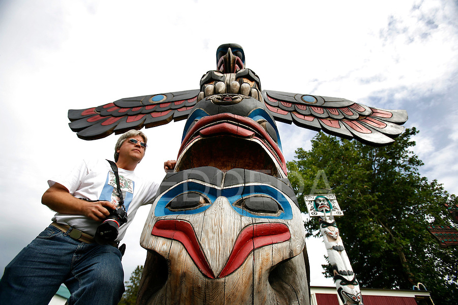 "Len Langevin, president of the Cowichan Valley Camera Club, takes photos of totem poles in Duncan, BC, the ""City of Totems"". The city of Duncan has placed a copyright policy on its 80 totem poles which also states that any use of the images in any form requires approval from the City of Duncan. Langevin has created a group on Facebook protesting the policy. Photo assignment for the Globe and Mail national newspaper in Canada."