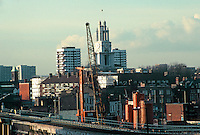London Docklands: Looking NW from West India Quay towards Hawksmoor's St. Anne's Limehouse from light rail. Photo '87.