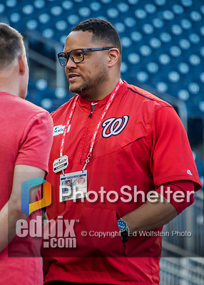 6 October 2017: Washington Nationals VP of Clubhouse Operations & Team Travel Rob McDonald chats with training coaches during batting practice prior to the NLDS Game 1 against the Chicago Cubs at Nationals Park in Washington, DC. The Cubs shut out the Nationals 3-0 to take a 1-0 lead in their best of five Postseason series. Mandatory Credit: Ed Wolfstein Photo *** RAW (NEF) Image File Available ***