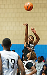 WATERBURY ,  CT-101219JS32-  A Windsor player puts up a three-point shot as they play St. Pat's of New Jersey during the second annual Stop the Violence Basketball Tournament held Saturday at the North End Rec Center in Waterbury. The tournament was started by former Sacred Heart High School basketball star Mustapha Heron. <br />  Jim Shannon Republican-American