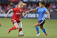Portland, Oregon - Saturday July 2, 2016: Portland Thorns FC midfielder Amandine Henry (28) controls the ball in front of Sky Blue FC midfielder Raquel Rodriguez (11) during a regular season National Women's Soccer League (NWSL) match at Providence Park.