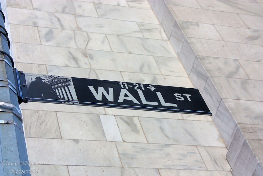 Wall Street sign against a marble wall in the financial district in NYC