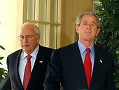 """United States Vice President Dick Cheney and United States President George W. Bush exit the Oval Office for the ceremony granting a Presidential Pardon to """"Biscuits"""" the Turkey in the Rose Garden at the White House on November 17, 2004.  This is an annual White House tradition celebrating the national holiday of Thanksgiving.  """"Biscuits"""" was provided by the National Turkey Federation, and was raised by Kevin Foltz and his family on their farm in Mathias, West Virginia.<br /> Credit: Ron Sachs / CNP"""