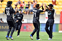 Blackcaps bowler Colin de Grandhomme celebrates the wicket of England's Joe Root with Ish Sodhi the catcher during the Third ODI game between Black Caps v England, Westpac Stadium, Wellington, Saturday 03rd March 2018. Copyright Photo: Raghavan Venugopal / © www.Photosport.nz 2018