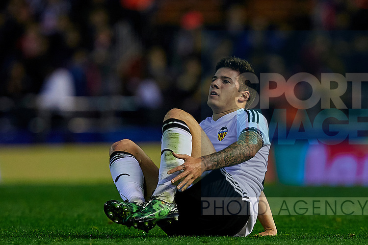 Santi Mina of Valencia CF lays down on the pitch after being tackled - UEFA Champions League Group H - Valencia CF vs Olympique Lyonnais - Mestalla Stadium - Valencia- Spain - 09th December 2015 - Pic David Aliaga/Sportimage