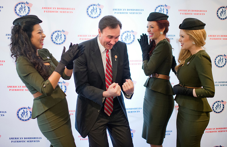 UNITED STATES - SEPTEMBER 10: Rep. Pete Olson, R-Texas, shares a laugh with singers American Bombshells, at the CHC Annual Clothing Drive at the Capitol Hill Club which helps veterans transition into the workplace, September 10, 2014. The Bombshells from left are, Jenn Aédo, Rayna Bertash, and Stephanie Leone. (Photo By Tom Williams/CQ Roll Call)
