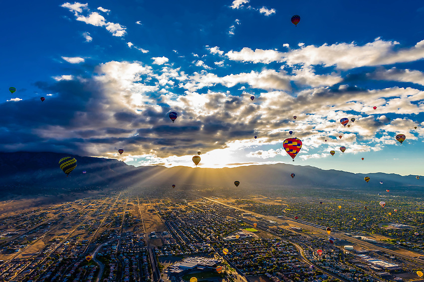 Hot air balloons flying at sunrise with the sandia mountains in hot air balloons flying at sunrise with the sandia mountains in the background sciox Choice Image