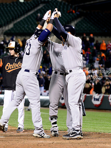 New York Yankees right fielder Nick Swisher (33), left, and first baseman Mark Teixeira (25), right, celebrate Swisher's two run home run in the tenth inning against the Baltimore Orioles at Oriole Park at Camden Yards in Baltimore, MD on Thursday, April 11, 2012.  The Yankees won the game 6 - 4..Credit: Ron Sachs / CNP.(RESTRICTION: NO New York or New Jersey Newspapers or newspapers within a 75 mile radius of New York City)