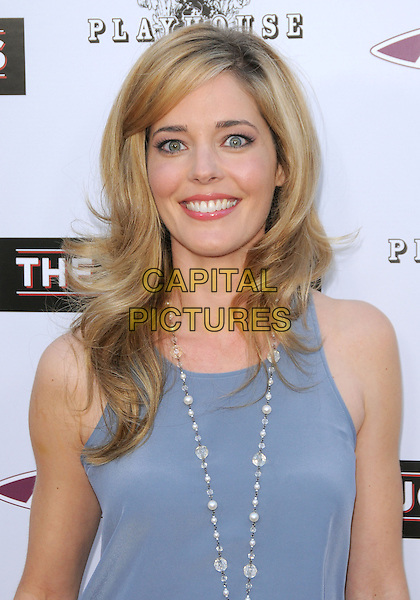 "CHRISTINA MOORE .at the L.A. Premiere of ""The Joneses"" held at The Arclight Theatre in Hollywood, California, USA, .April 8th, 2010..arrivals portrait headshot smiling grey gray vest top necklace                                                                    .CAP/RKE/DVS.©DVS/RockinExposures/Capital Pictures."