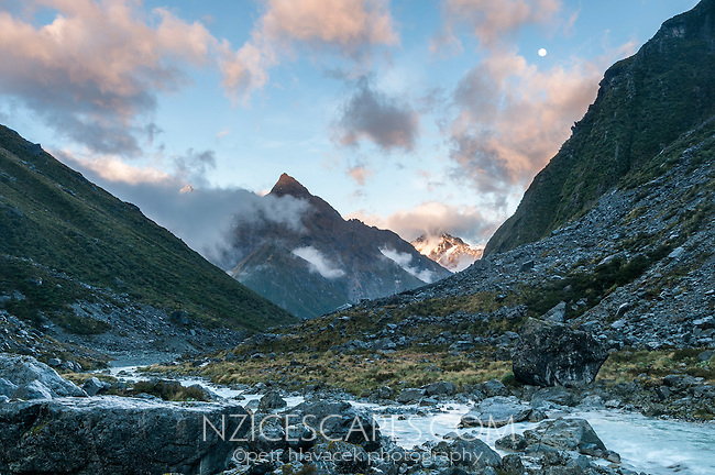 Sunrise with full moon at Ice Lake with Butler River, Westland National Park, West Coast, New Zealand