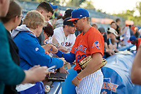 Syracuse Mets Brandon Nimmo (23) signs autographs before an International League game against the Charlotte Knights on June 11, 2019 at NBT Bank Stadium in Syracuse, New York.  Syracuse defeated Charlotte 15-8.  (Mike Janes/Four Seam Images)