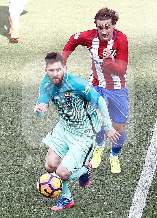 Atletico de Madrid's Antoine Griezmann (r) and FC Barcelona's Leo Messi during La Liga match. February 26,2017. (ALTERPHOTOS/Acero)
