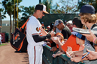 Baltimore Orioles left fielder Austin Hays (21) signs autographs for fans before a Grapefruit League Spring Training game against the Detroit Tigers on March 3, 2019 at Ed Smith Stadium in Sarasota, Florida.  Baltimore defeated Detroit 7-5.  (Mike Janes/Four Seam Images)