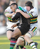 Twickenham. GREAT BRITAIN, Quins's, Jorden TURNER-HALLis tackle by Darren Fox and Christian SHORT [cap],  during the, Guinness Premiership game between, NEC Harlequins and Northamption Saints, on Sat., 04/11/2006, played at the Twickenham Stoop, England. Photo, Peter Spurrier/Intersport-images].....