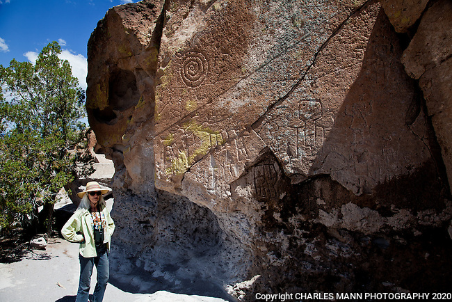 Hikers at the Tsankawi trail, an outlier of Bandelier National Monument near Los Alamos, New Mexico, encounter cave shelters, petroglyphs, an ancient pueblo site and colorful scenery.