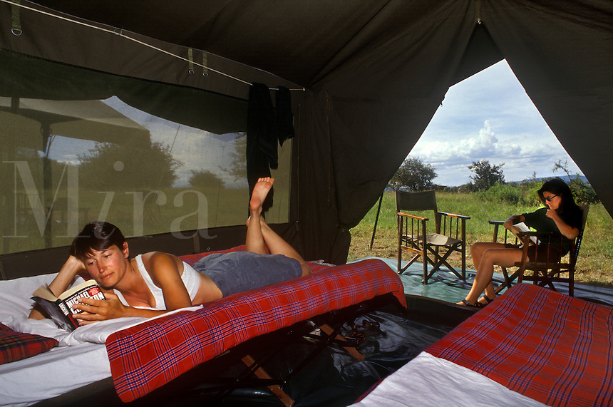Comfortable beds make for a pleasant siesta during the miday heat at our TENT CAMP in MORU KOPJES AREA - SERENGETI NATIONAL PARK, TANZANIA