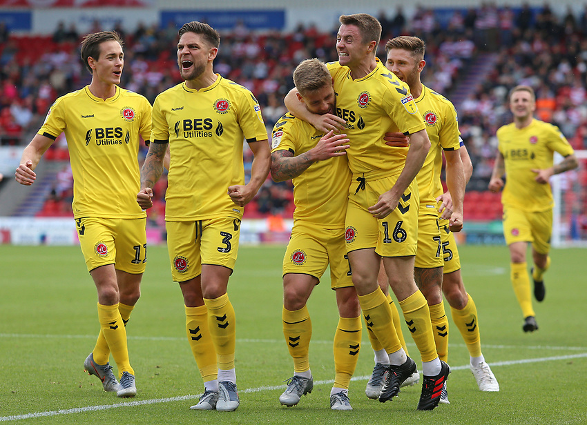 Fleetwood Town's Conor McAleny celebrates scoring the opening goal with Jordan Rossiter<br /> <br /> Photographer David Shipman/CameraSport<br /> <br /> The EFL Sky Bet League One - Doncaster Rovers v Fleetwood Town - Saturday 17th August 2019  - Keepmoat Stadium - Doncaster<br /> <br /> World Copyright © 2019 CameraSport. All rights reserved. 43 Linden Ave. Countesthorpe. Leicester. England. LE8 5PG - Tel: +44 (0) 116 277 4147 - admin@camerasport.com - www.camerasport.com