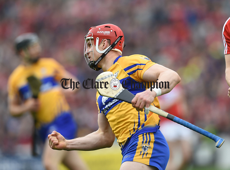 John Conlon of Clare celebrates scoring the opening point against Cork during their Munster Senior game at Pairc Ui Chaoimh. Photograph by John Kelly.