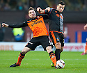 Dundee Utd's Paul Paton and Killie's Alexei Eremenko challenge for the ball.