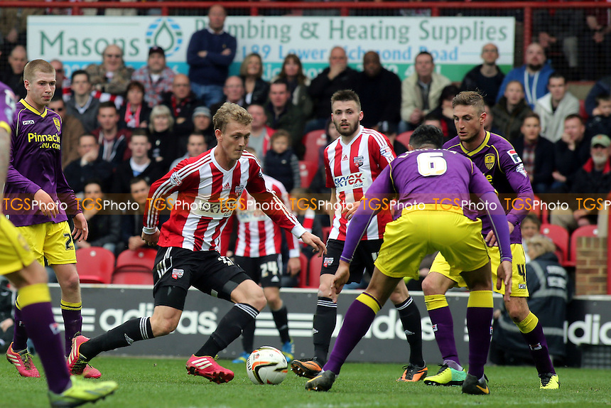George Saville of Brentford takes on Notts County's Dean Leacock - Brentford vs Notts County - Sky Bet League One Football at Griffin Park, London - 05/04/14 - MANDATORY CREDIT: Paul Dennis/TGSPHOTO - Self billing applies where appropriate - 0845 094 6026 - contact@tgsphoto.co.uk - NO UNPAID USE