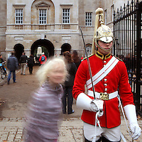 A young girl hurries to a Life Guards on duty for a souvenir shot, Horse Guards building, 1751 - 1753, by John Vardy and William Kent, London, UK. Picture by Manuel Cohen