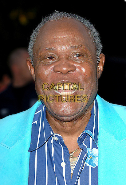 SAM MOORE.attending the 2006 MOBO Awards, Royal Albert Hall, London, England, 20th September 2006..portrait headshot turquoise jacket blue white striped shirt.Ref: BEL.www.capitalpictures.com.sales@capitalpictures.com.©Tom Belcher/Capital Pictures.