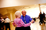 Couples dance at the Singles Dance at the Sundial Auditorium in Sun City Friday night, January 8, 2010.